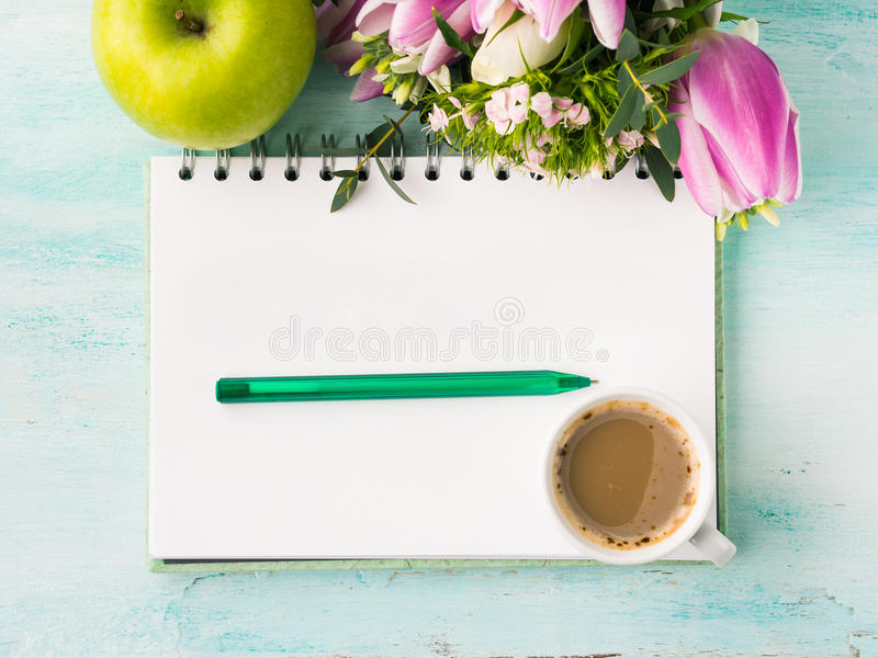 Blank notebook page with pen and cup of coffee stock image
