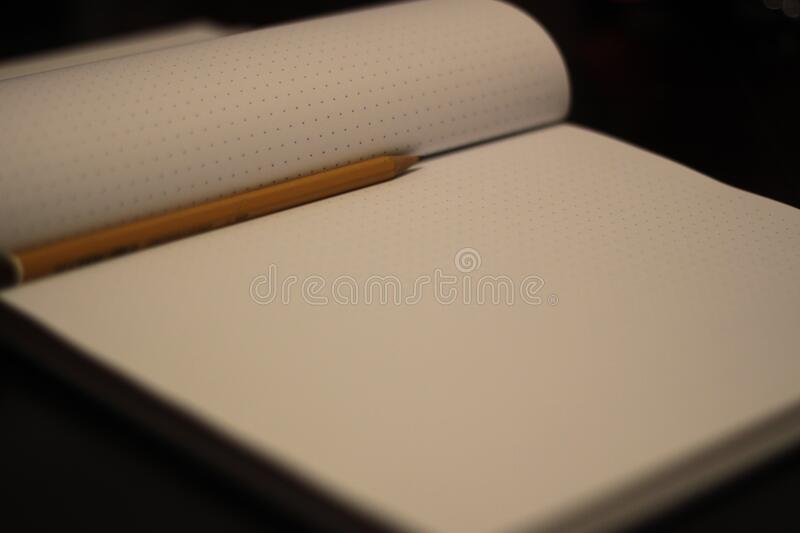 Blank notebook and pencil stock photo