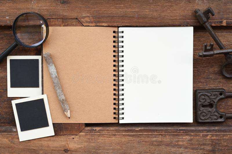 Blank notebook with pencil, key and magnifying glass royalty free stock photos