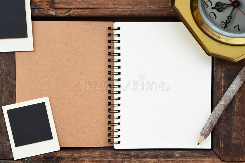 Blank notebook, photo frame, pencil and clock royalty free stock images