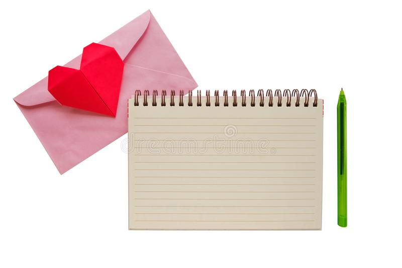 Blank notebook with pink envelope and red heart paper origami royalty free stock photo