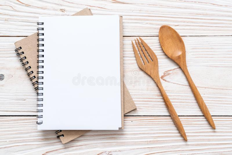 blank notebook for text note on wooden surface with copy sapce royalty free stock image