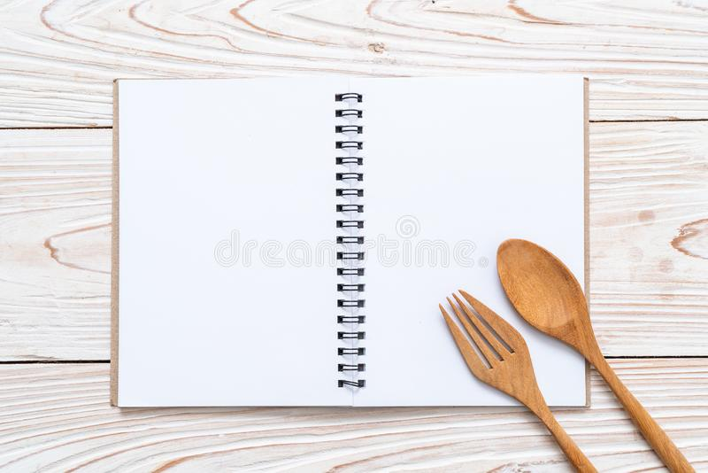 blank notebook for text note on wooden surface with copy sapce royalty free stock photo
