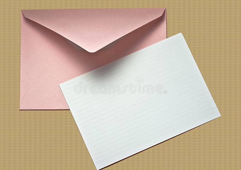 Blank Notecard and Envelope on Cork. Pink envelope and bland note card on cork board stock image