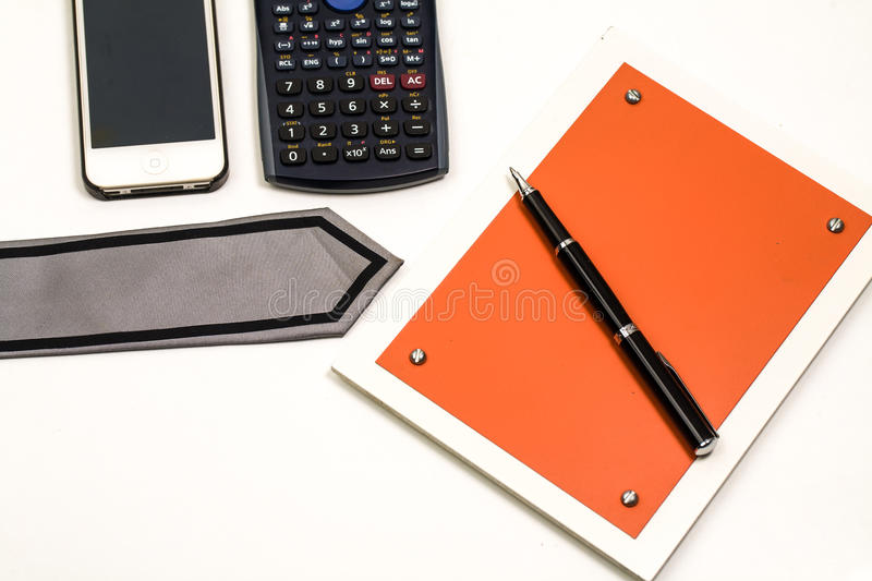 Blank notepad and accessories for business people. In the office stock image