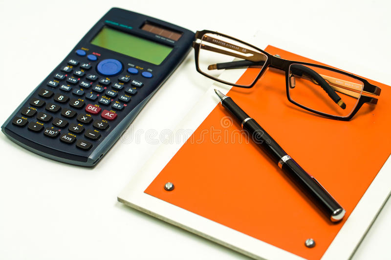 Blank notepad and accessories for secretary in the office. Calculator stock photography