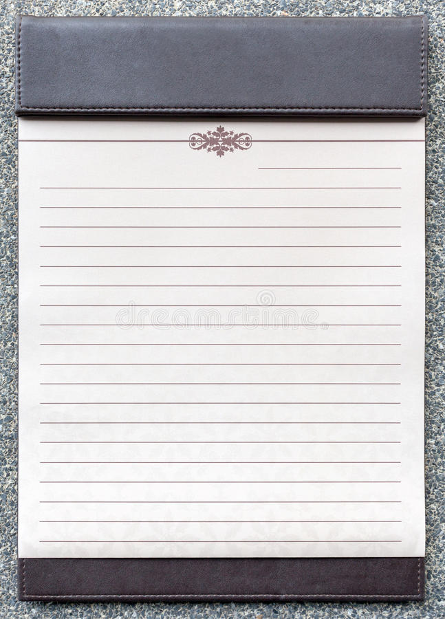 Blank notepad on the brown clipboard. Blank notepad on the brown clipboard, for memorandum in meeting room royalty free stock image