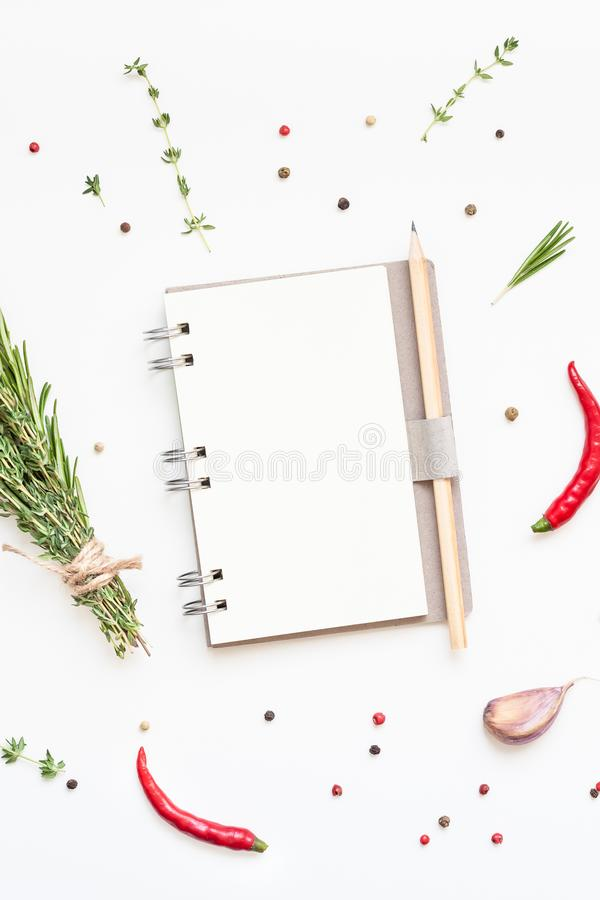 Blank notepad pages with greens herbs and spices. Flat lay overhead view blank notebook pages mockup text space invitation card on white background with greens royalty free stock photography
