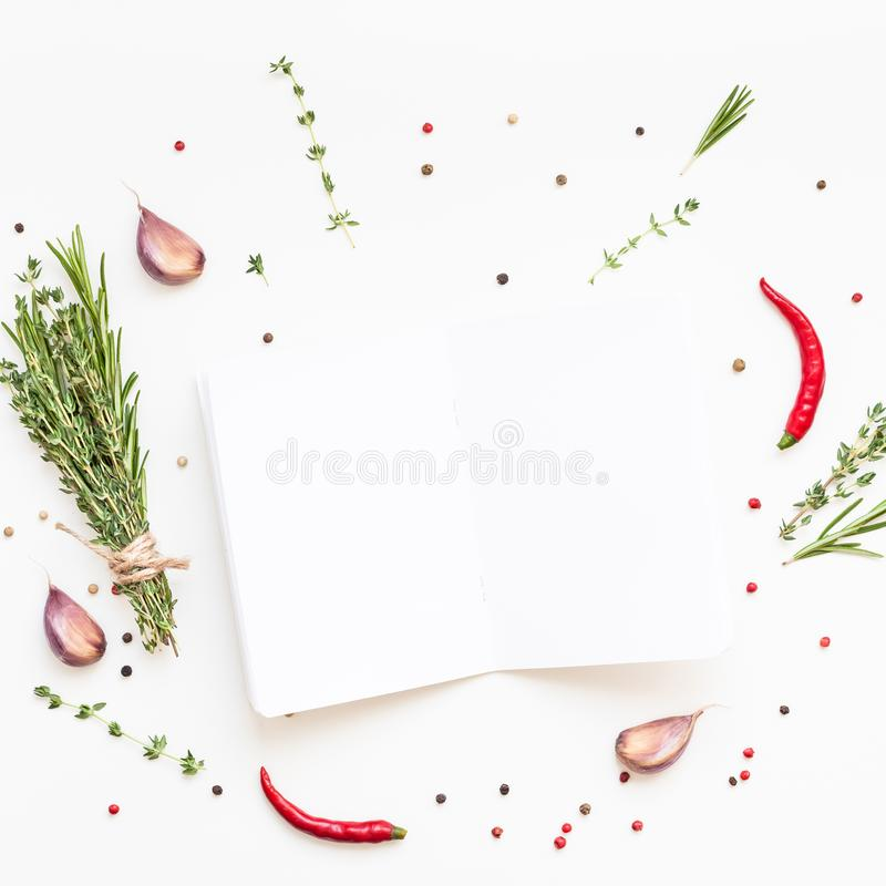 Blank notepad pages with greens herbs and spices. Flat lay overhead view blank notebook pages mockup text space invitation card on white background with greens stock photos