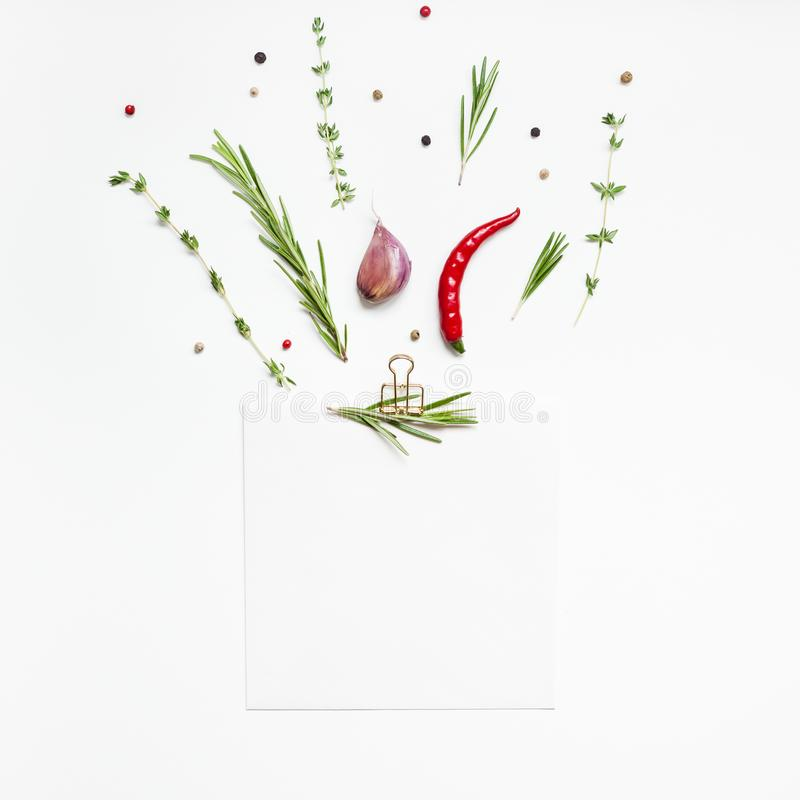 Blank notepad pages with greens herbs and spices. Flat lay overhead view blank notebook pages mockup text space invitation card on white background with greens royalty free stock photos
