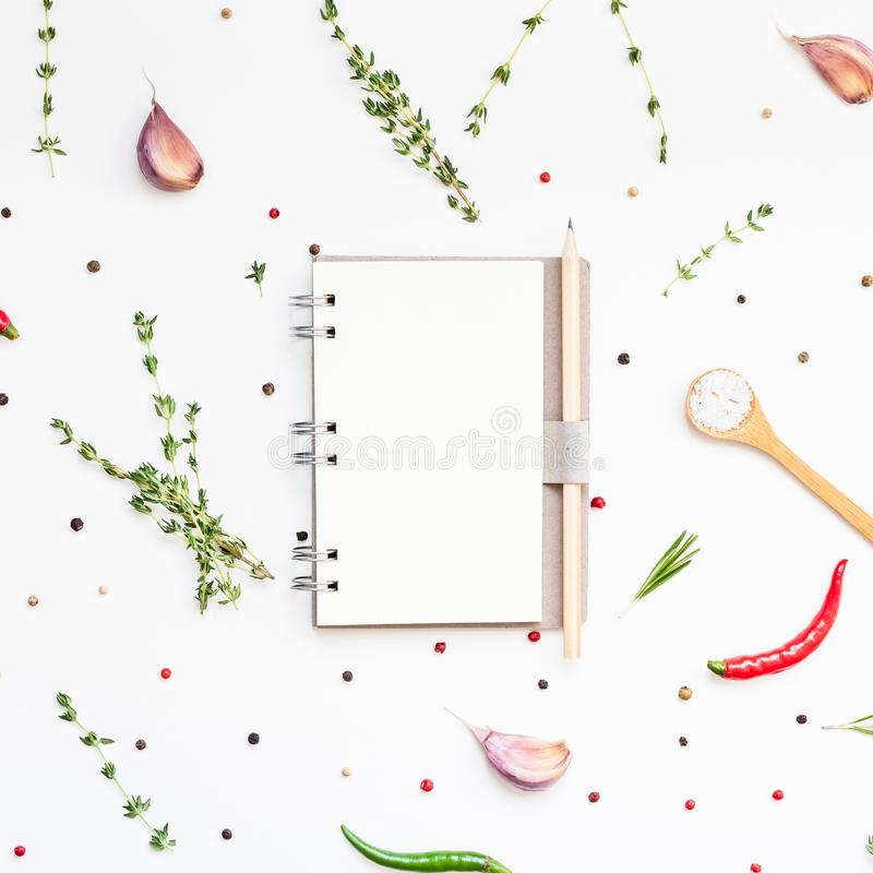 Blank notepad pages with greens herbs and spices. Flat lay overhead view blank notebook pages mockup text space invitation card on white background with greens stock image