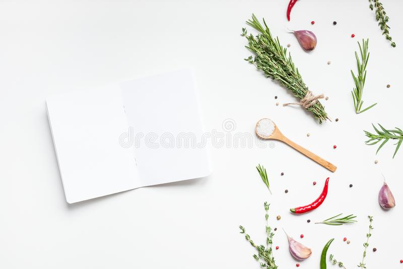 Blank notepad pages with greens herbs and spices. Flat lay overhead view blank notebook pages mockup text space invitation card on white background with greens royalty free stock image