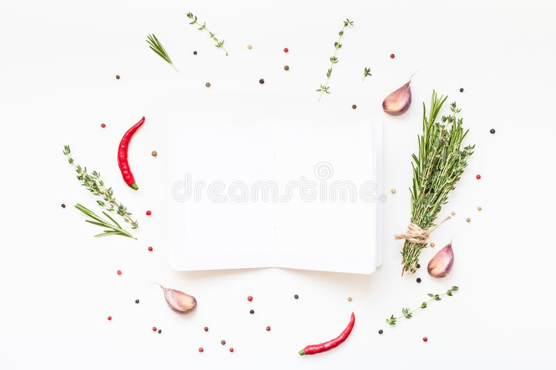 Blank notepad pages with greens herbs and spices. Flat lay overhead view blank notebook pages mockup text space invitation card on white background with greens stock images