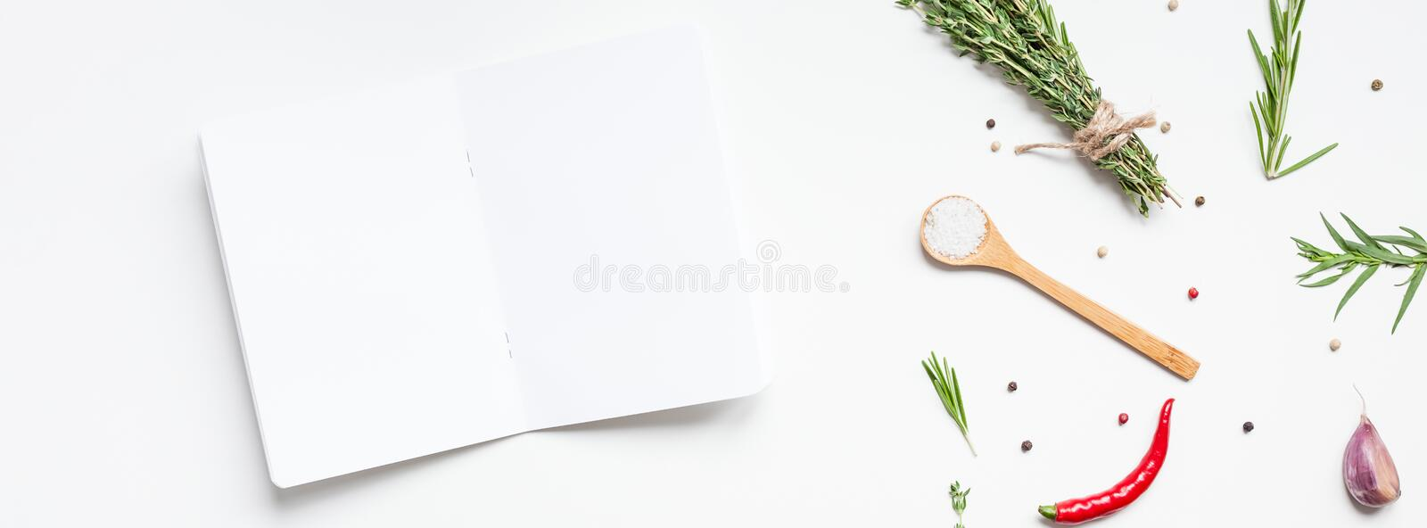 Blank notepad pages with greens herbs and spices. Flat lay overhead view blank notebook pages mockup text space invitation card on white background with greens royalty free stock images
