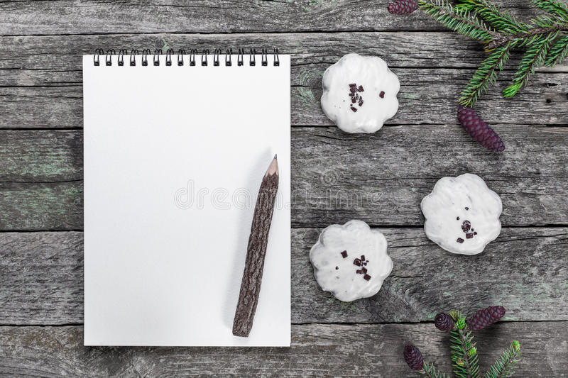 Blank Notepad with pencil, Christmas cookies and spruce branches royalty free stock images