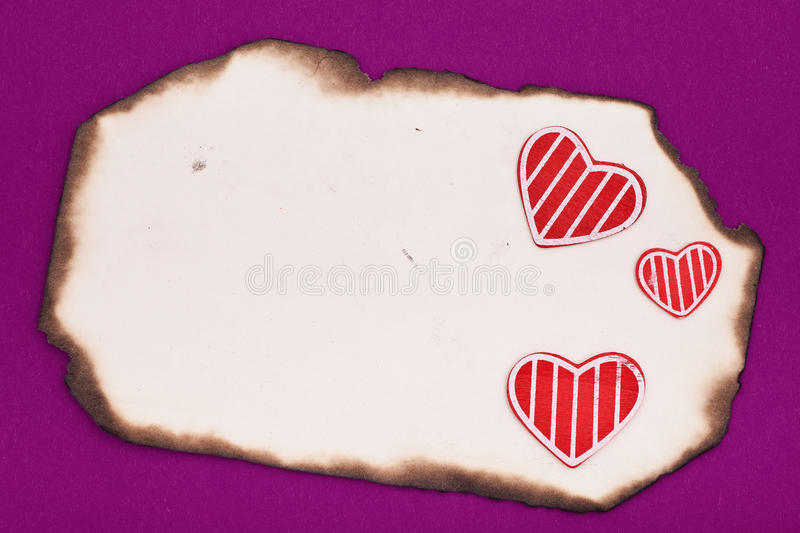 Blank old burnt paper and hearts