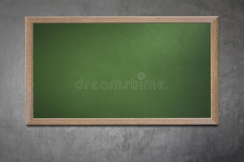 Blank old school blackboard on a grunge wall and can input text. Or data to wooden frame for concept of education royalty free stock photography