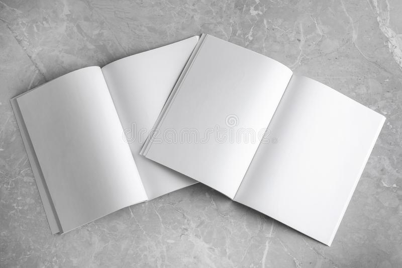 Blank open books on light grey marble background. Mock up for design. Blank open books on light grey marble background, top view. Mock up for design royalty free stock photography