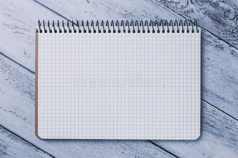 Blank open spiral notebook close-up. Concept of planning . Gray wood background of boards. Copy space. stock images