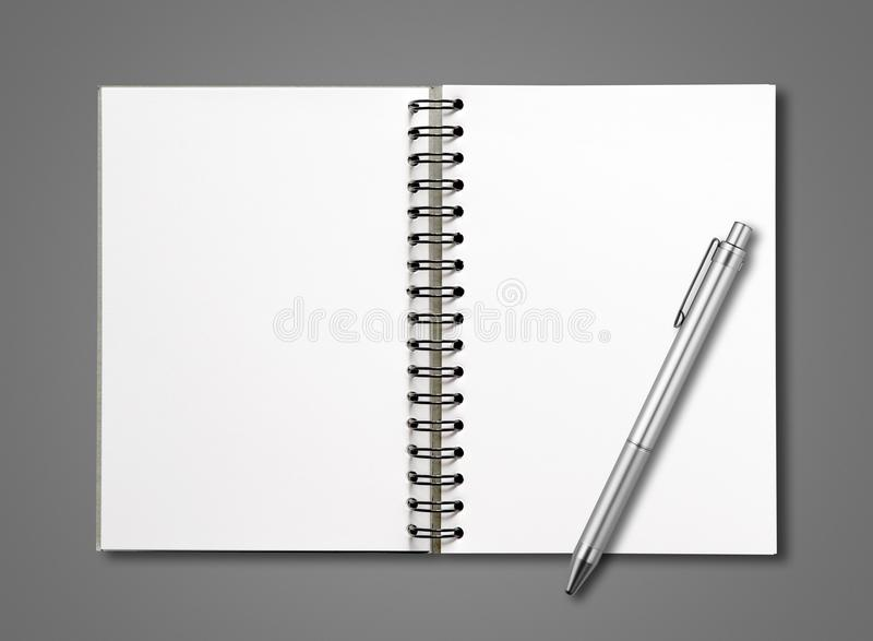Blank open spiral notebook and pen isolated on dark grey stock photography