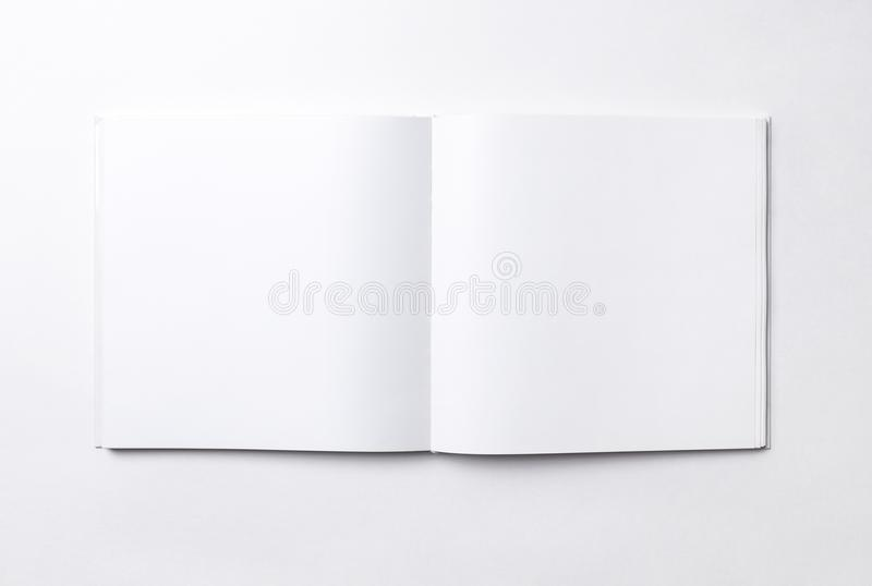 Blank open square book, white background stock photography