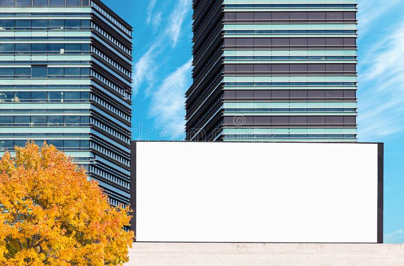 Blank outdoor billboard mockup with modern business buildings stock image