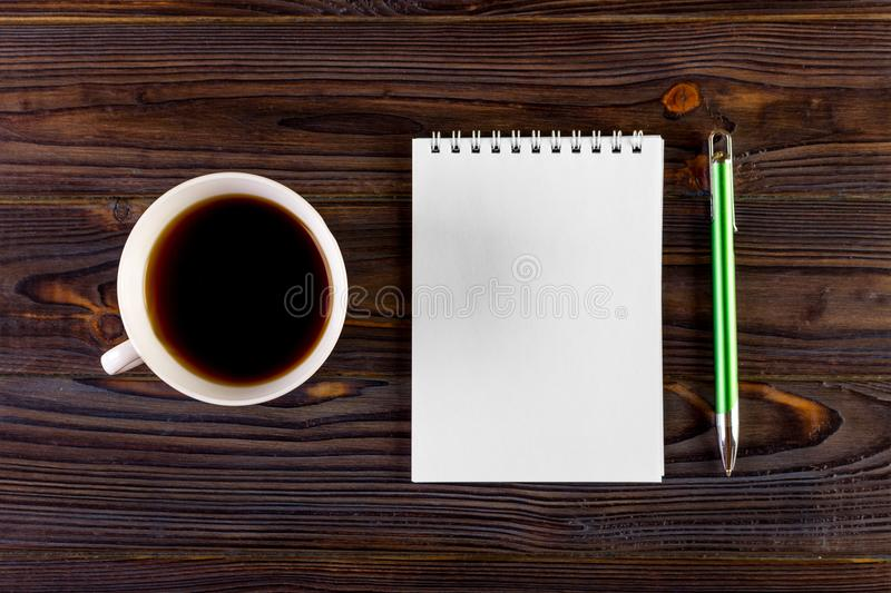 Blank Pad of Paper ready for your own text, Pen Coffee royalty free stock image