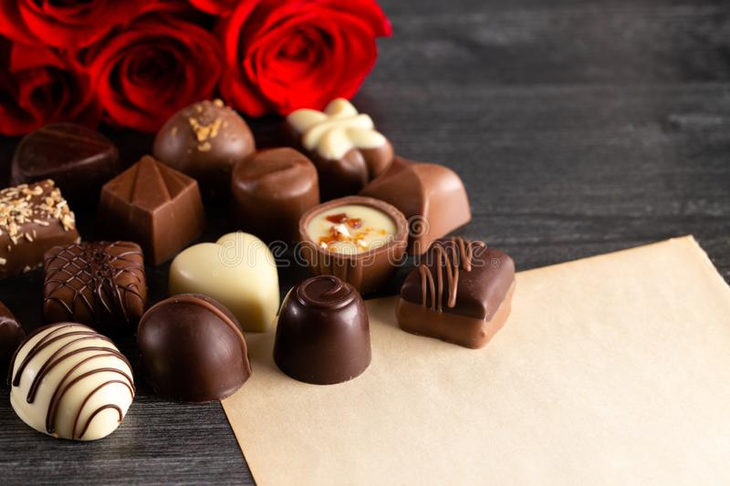 Blank Page for a Love Letter with Chocolates and Roses. A Blank Page for a Love Letter with Chocolates and Roses royalty free stock photography