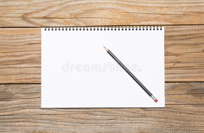 Blank page of a sketchbook with a black pencil royalty free stock photo
