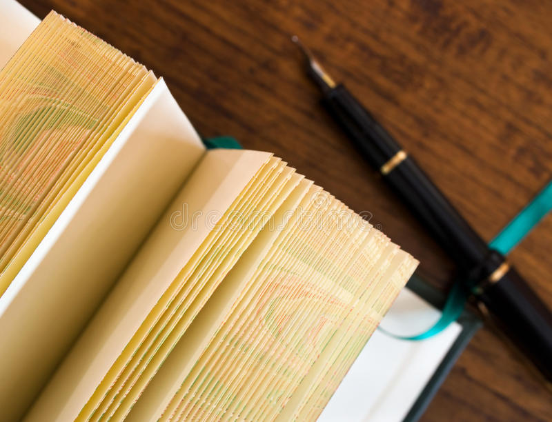 blank pages of open journal with pen stock photo