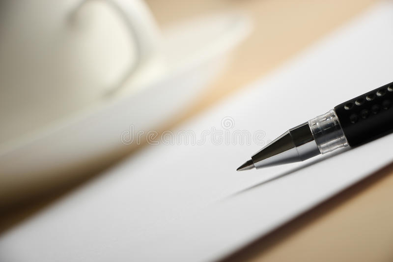 Blank paper with ball pen and coffee stock photos