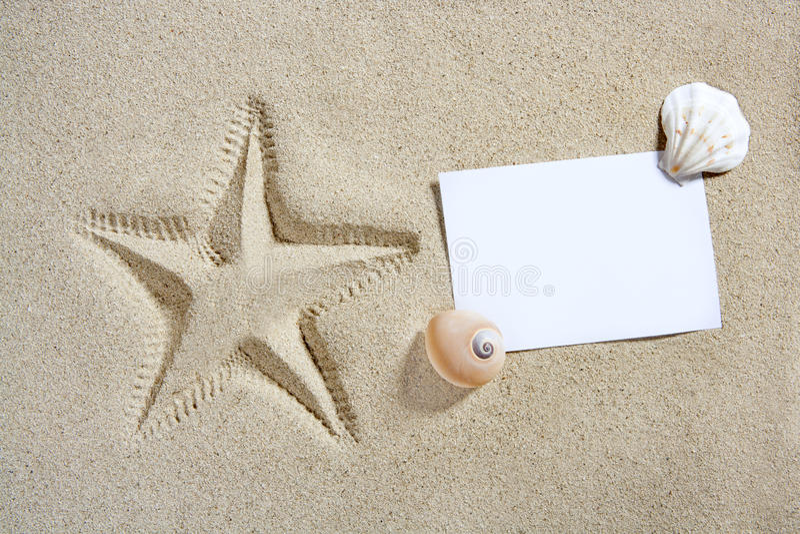 Blank paper beach sand starfish pint shells summer stock image