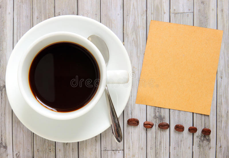 Blank paper with coffee cup and coffee beans. Blank paper with hot coffee cup and coffee beans royalty free stock photos