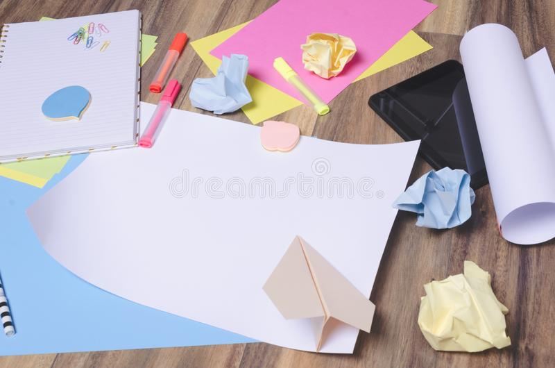 Blank paper among different stationary stuff.Concept of start up beginning, brainstorming stock photography