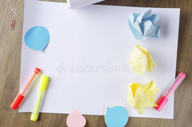 Top view of crumpled paper,stationary and white blank sketch paper.Concept of  brainstorm and thinking up an original ideas royalty free stock image