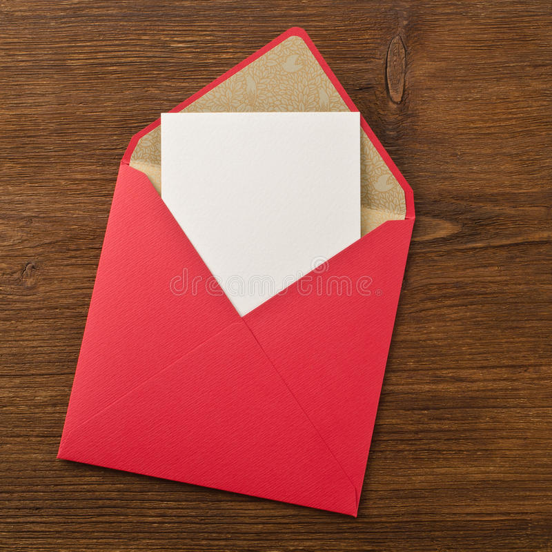 Blank paper and envelope. On wooden background stock photos