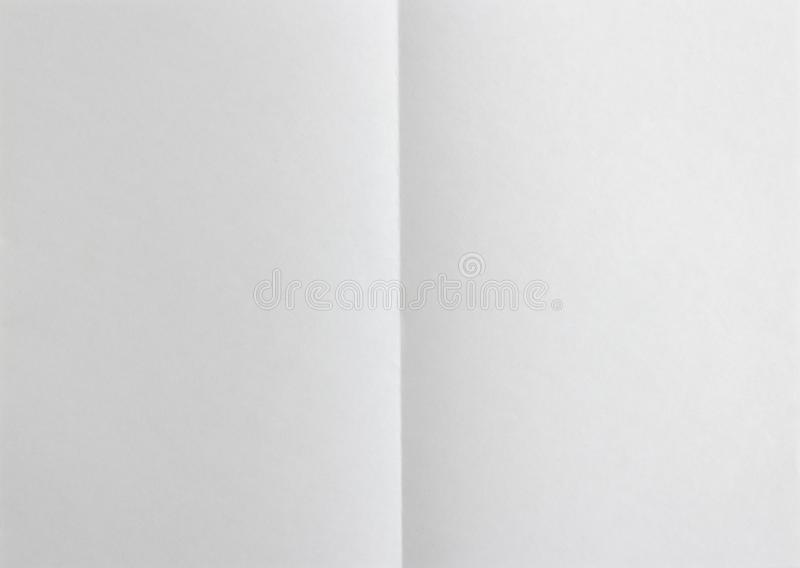 Blank paper folded on two. Background stock photo