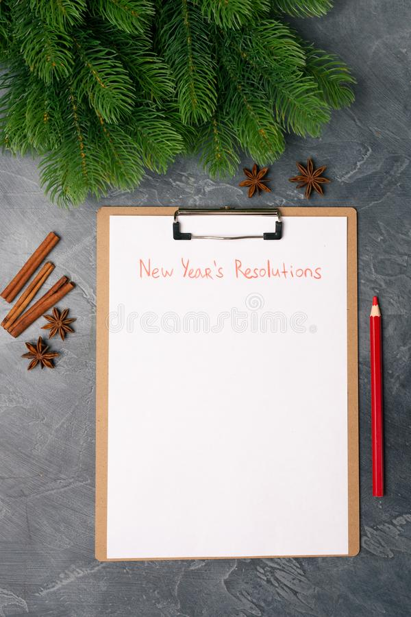 Blank paper with new year`s resolutions title. Flat lay. Top view. New year concept. Target success concept. Blank paper with new year`s resolutions title and stock photography