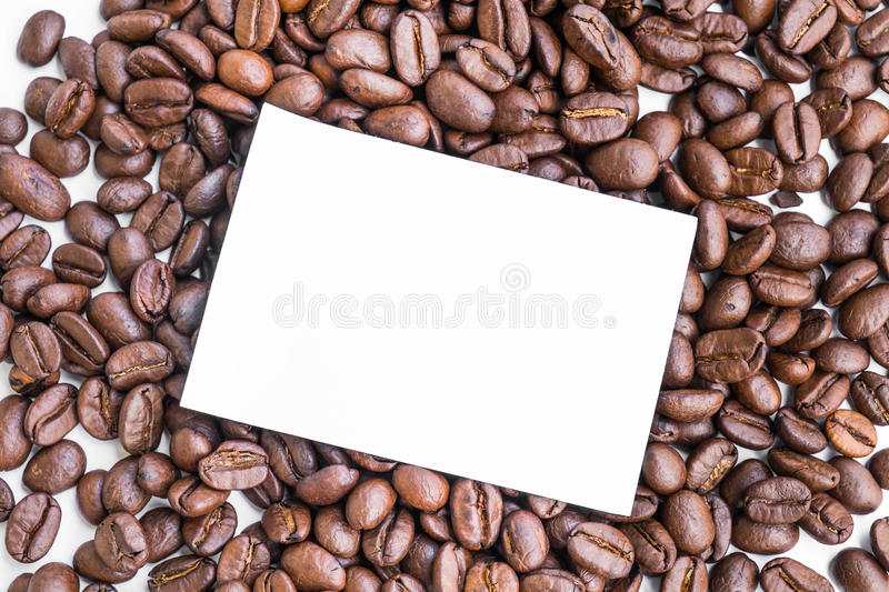 Blank paper note on roasted coffee beans. Blank paper note, on roasted coffee beans royalty free stock image
