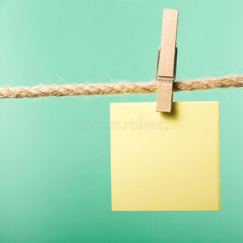 Blank paper notes hanging on rope with clothes pins, copy space royalty free stock photos