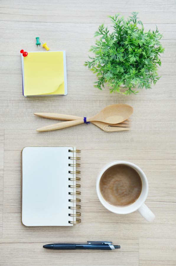 Blank paper and office tools on the wood table - Top view stock image
