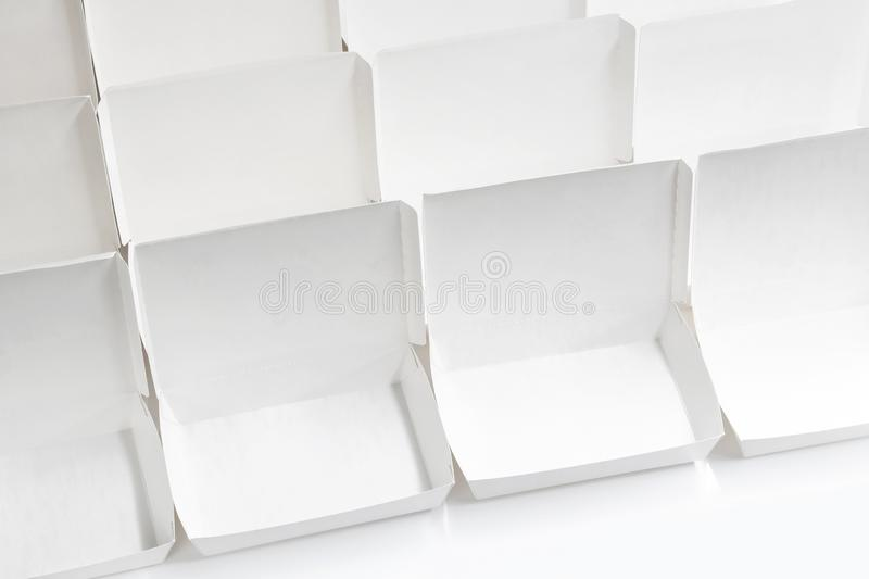Blank paper package white box for food products on the white background. Concept order online shopping fast food delivery service stock images