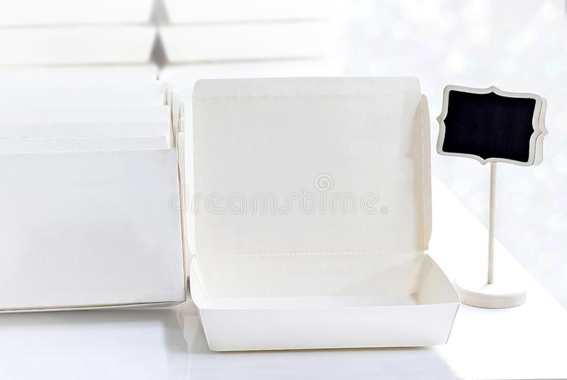 Blank paper package white box for food products and logo branding on the white table background. stock photos