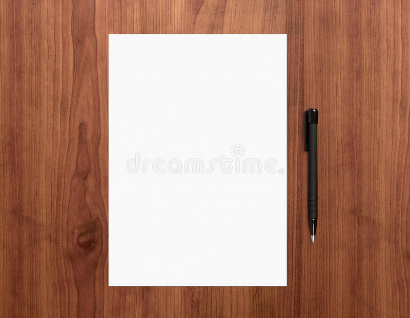 Blank paper with pen on desk