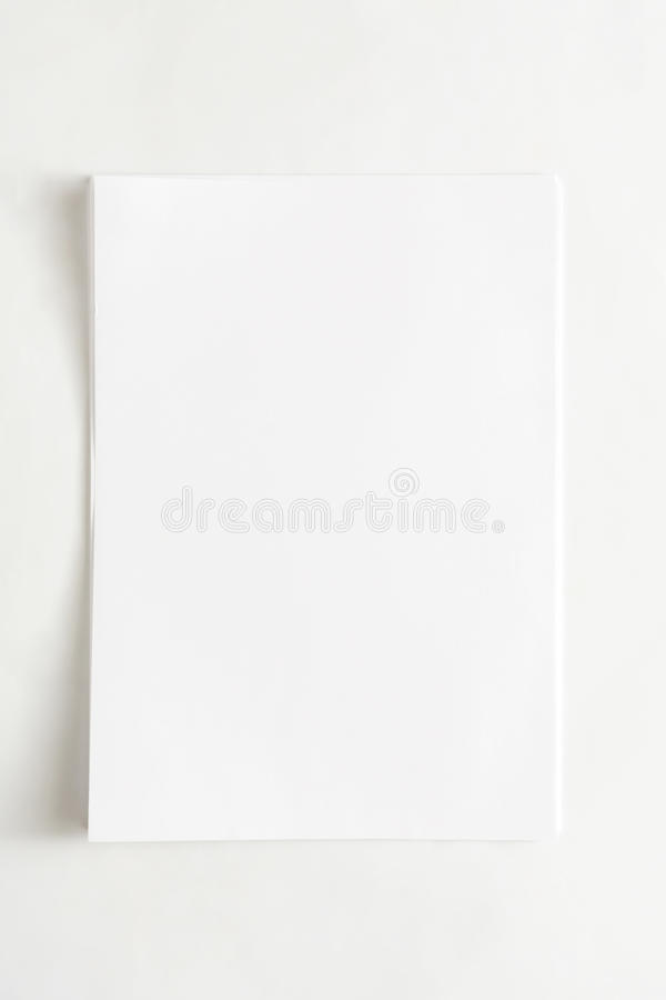 Blank paper sheet attached with clip isolated on white background royalty free stock photography