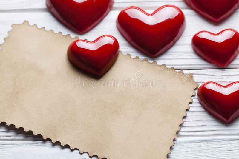 Blank paper sheet and red hearts royalty free stock images