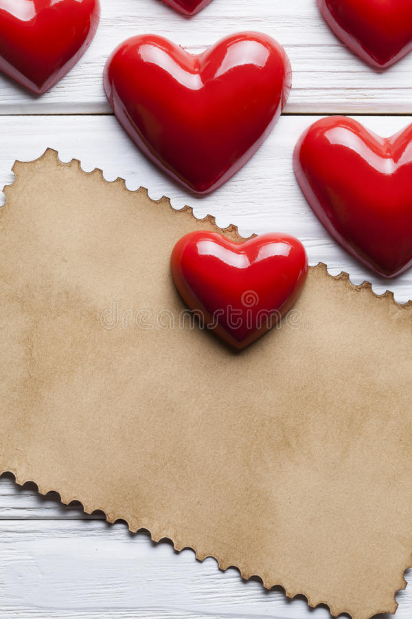 Blank paper sheet and red hearts stock photography