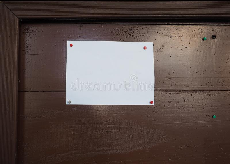 Blank paper sign. Blank A4 paper sign on a wooden board stock photography
