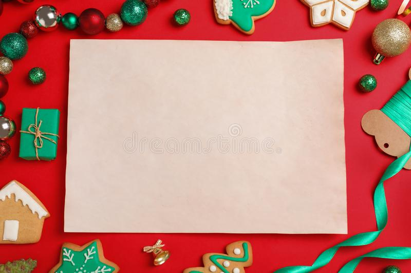 Blank paper with space for text and Christmas decor on red background. Letter to Santa Claus. Blank paper with space for text and Christmas decor on red royalty free stock photography