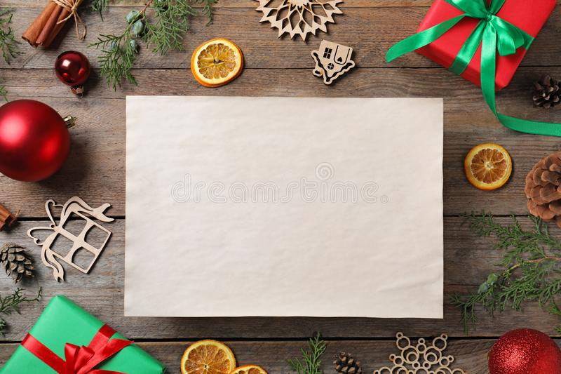 Blank paper with space for text and Christmas decor on wooden background, flat lay. Letter to Santa. Claus stock photos